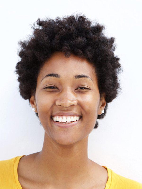 closeup-of-a-smiling-young-black-woman-PJGUSWC.jpg