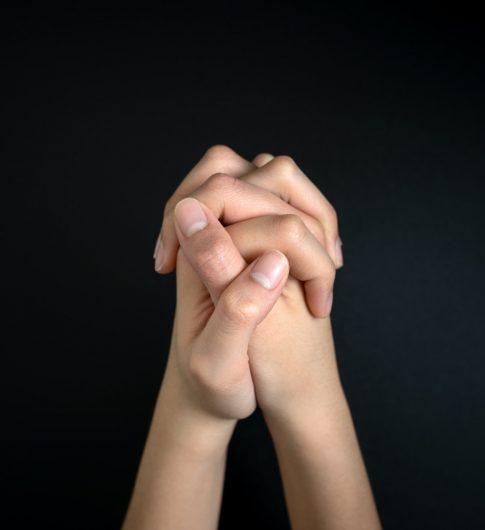 Praying hands is in the dark